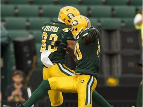 Edmonton's Brandon Zylstra (83) celebrates a touchdown with Chris Williams (80) during a CFL game between the Edmonton Eskimos and the BC Lions at Commonwealth Stadium in Edmonton on Friday, July 28, 2017.