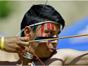 Landon Sasakamoose from the Ahtahkakoop Cree Nation in Saskatchewan takes aim in the bow and arrow competition at the 2017 World Indigenous Nations Games. The event was held on the Enoch Cree Nation reserve west of Edmonton on Monday July 3, 2017.