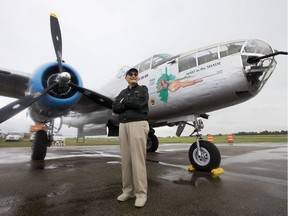 Retired B-25 pilot Gerry Regehr poses for a photo with a Second World War B-25J Mitchell bomber at the Villeneuve Airport, west of Edmonton, on Friday Aug. 4, 2017.