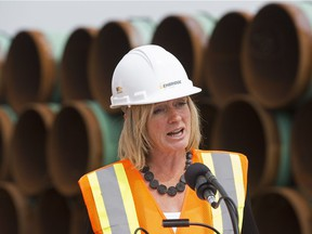 Premier Rachel Notley speaks to the media during a stop at a pipeline stockpile site for Enbridge's Line 3 pipeline replacement project, near Hardisty Thursday, Aug. 10, 2017.