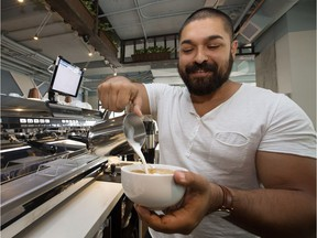 Owner Jorel Pepin makes a latte at the newly opened Monument Coffee, 10803 Jasper Avenue, in Edmonton Monday Aug. 14, 2017.