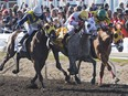 Rico Walcott on Chief Know It All managed to hold off challengers on both sides to win the 88th Running of the Canadian Derby at Northlands Park in Edmonton on Saturday Aug. 19, 2017.