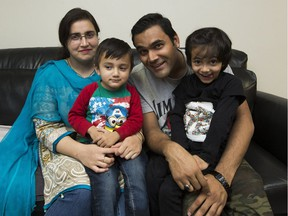 New immigrants are bringing or having children in Edmonton, which is pushing up the numbers of English language learners in Edmonton's public and Catholic schools. New immigrants Adeela Javed, left, her husband Ghazanfar Siraj and their children Muhammed, 2, and Meesha, 5, pose for a photo on Oct. 25, 2017, in Edmonton.