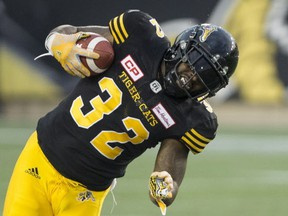 Hamilton Tiger-Cats running back C.J. Gable (32) is tackled by Toronto Argonauts defensive back Brandon Harris (4) during first half CFL football action in Hamilton, Ont., on Sept. 4, 2017.