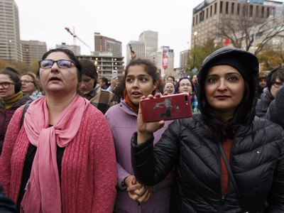 Edmontonians sing Oh Canada during the Stand Together Against Violence in Solidarity with EPS vigil organized by Alberta Muslim Public Affairs Council at Churchill Square in Edmonton, Alberta after a police officer and four bystanders were injured in a terrorist attack on Sunday, October 1, 2017.