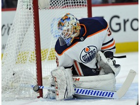 Edmonton Oilers goalie Cam Talbot (33) makes a save during the first period of an NHL hockey game against the Chicago Blackhawks Thursday, Oct. 19, 2017, in Chicago.