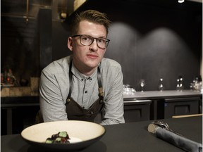 Alder Room chef and co-owner Ben Staley poses for a photo with the restaurant's beet root, blueberries and hay cream dish in Edmonton, Alberta on Wednesday, Nov. 1, 2017.