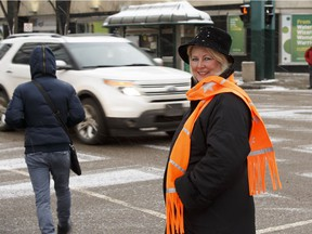 Irene Dixon of Reflective Advantage poses with her pedestrian-friendly high visibility products in Edmonton, Alberta on Thursday, November 2, 2017.