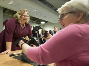 Health Minister Sarah Hoffman (left) chats with Moving for Memory program participant Mae Gerow, as she uses an arm ergometer at the Edmonton Southside Primary Care Network, 3110 Calgary Trail, in Edmonton Tuesday, Dec. 19, 2017. Hoffman unveiled Alberta's new provincial dementia strategy during a press conference at the centre Tuesday.