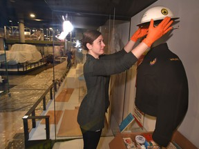 Susan Green, a conservator, installing items in a nuclear readyness exhibit in the human history gallery as the media were taken on a brief behind the scenes look at the Royal Alberta Museum as it continues to install artifacts into exhibits, in Edmonton, Dec. 6, 2017.