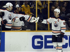Edmonton Oilers center Connor McDavid (97) is congratulated after scoring a goal against the Nashville Predators on Tuesday, Jan. 9, 2018, in Nashville, TN.