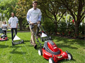 Mayor Don Iveson demonstrates how to leave grass clippings on the lawn to improve soil nutrients and reduce waste.