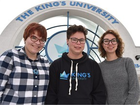 The King's University students Emma Van Arragon, left, Shylo Rosborough and Erin Wassing  are members of SPEAK, the Sexuality, Pride, and Equality Alliance which organized the first Pride event at the university last week.