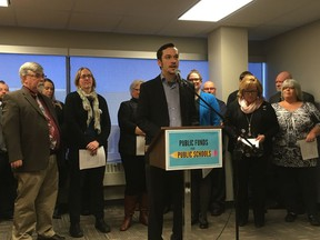 Public Interest Alberta executive director Joel French speaks at a press conference about a proposal to reduce public funds allotted to Alberta private schools.