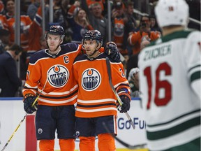 Edmonton Oilers centre Connor McDavid (97) and defenceman Andrej Sekera (2) celebrate a goal against the Minnesota Wild during second period NHL action in Edmonton on March 10, 2018.