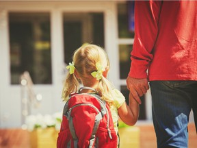 father and little daughter go to school or daycare, education for a story by Julia Lipscombe