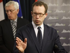 Marlin Schmidt, Minister of Advanced Education, speaks about new regulations limiting the compensation of post-secondary presidents next to Darryl Howell, board chair of Lakeland College, during a news conference at the Alberta Legislature in Edmonton, on Tuesday, April 10, 2018.