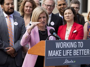 Surrounded by members of her NDP caucus, Alberta Premier Rachel Notley announces that the Government of Canada has purchased the Trans Mountain Pipeline and associated assets, during a press conference outside the Alberta Legislature in Edmonton on Tuesday, May 29, 2018.