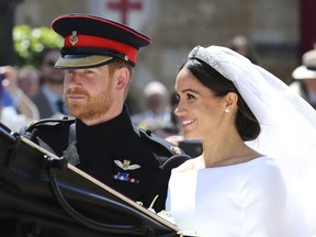 Meghan Markle and Prince Harry leave after their wedding ceremony, at St. George's Chapel in Windsor Castle in Windsor, near London, England, Saturday, May 19, 2018. (Gareth Fuller/pool photo via AP) ORG XMIT: RWW630
