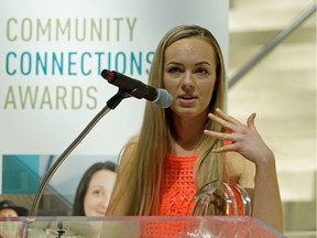 Callie Lissinna, representing the AlbertaSat Student Satellite Group, accepts the Community Leader Award at the Community Connection Awards ceremony held at Edmonton City Hall on Monday May 7, 2018.