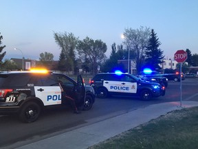 Investigators cordoned off a stretch of 144 Avenue near 92 Street on May 21, 2018, after a young boy was struck by a vehicle. Police at the scene said the boy was believed to be six years old.