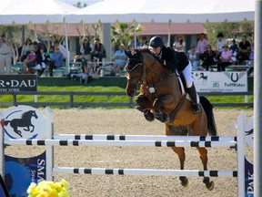 Edmonton-based show jumper Jaclyn Duff and horse EH All or None clearing a hurdle in 2016.