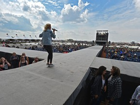 Singer/song writer Annika Odegard of Leaving Thomas performing on stage which has changed this year with the runways has effected the seating at the Big Valley Jamboree 2018 in Camrose, August 3, 2018.
