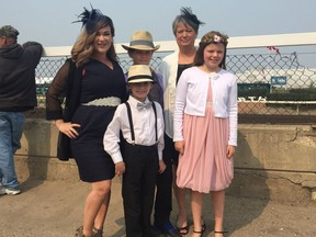 (Left to right) Brigitte Arsenault, Mason Arsenault (front), Gabriel Arsenault, Donna Hynes and Sophia Arsenault came from Camrose for the final Canadian Derby at Northlands.