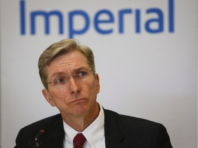 Rich Kruger, president and CEO of Imperial Oil, listens to a questions as he speaks to the media following the company's annual meeting in Calgary, Friday, April 29, 2016.
