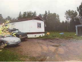 A mobile home on Jean Baptiste First Nations Reserve where a father and son were shot during a 2016 home invasion.