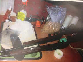 A crime scene photo of guns police discovered while searching a trailer linked to a suspect in a 2016 shooting in Calling Lake, Alta. were entered as exhibits during a trial in Edmonton in August 2018.