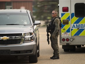 Police investigate a shooting near Minchau School at 3705 Millwoods Road on Tuesday, Aug. 14, 2018 in Edmonton.