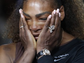 Serena Williams reacts during the trophy ceremony in the women's final of the U.S. Open tennis tournament, Saturday, Sept. 8, 2018, in New York. Naomi Osaka, of Japan, defeated Williams. (AP Photo/Adam Hunger)