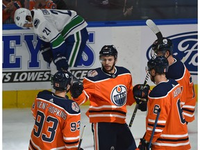 Edmonton Oilers Ty Rattie (8) celebrates his first of three goals n the night with teammates against the Vancouver Canucks during NHL pre-season action at Rogers Place in Edmonton, September 25, 2018.