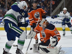 Edmonton Oilers goalie Cam Talbot (33) makes a save off Vancouver Canucks Bo Horvat (53) during NHL pre-season action at Rogers Place, Sept. 25, 2018.