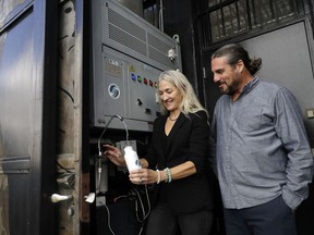 The Skysource/Skywater Alliance co-founders David Hertz, right, and his wife Laura Doss-Hertz demonstrate how the Skywater 300 works Wednesday, Oct. 24, 2018, in Los Angeles.