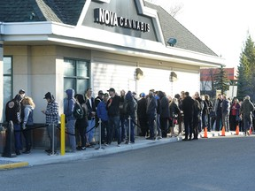 Customers line up outside Nova Cannabis in north Edmonton, waiting for the store to open on the first day of legalized cannabis in Canada on Wednesday, Oct. 17, 2018.