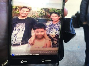 Ricky Massin Cenabre, pictured with his son John Cedric Cenabre and fiancé Editha Alcazaren-Cenabre, prior to his departure from the Philippines for Canada, where he was shot and killed while working in an Edmonton convenience store on Dec. 18, 2015.