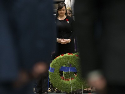 Memorial Cross recipient Lisa Schamehorn - Eades is framed by soldiers during the Remembrance Day Service at the University of Alberta's Van Vliet Centre, in Edmonton Sunday Nov. 11, 2018. Her husband, Sgt. Shawn Eades, died Aug. 20, 2008, during his third tour in Afghanistan.