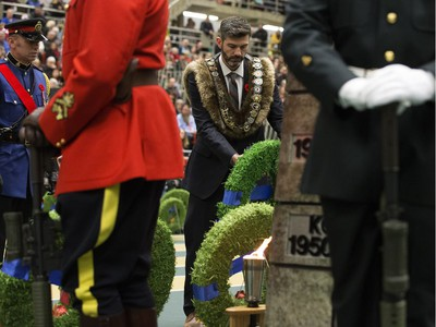 Edmonton Mayor Don Iveson lays a wreath during the Remembrance Day Service at the University of Alberta's Van Vliet Centre, in Edmonton Sunday Nov. 11, 2018.