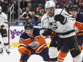 Los Angeles Kings centre Anze Kopitar is chased by Edmonton Oilers star Connor McDavid and defenceman Brandon Davidson during NHL action in Edmonton on Jan. 2, 2018.