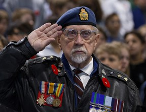 Royal Air Force veteran Jack Jamieson salutes as he takes part in a Remembrance Day ceremony at Vimy Ridge School in Edmonton on Friday November 9, 2018. (Photo by David Bloom)