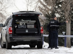 Police and emergency crews in a field behind Queen Elizabeth School, 9425 132 Ave., in Edmonton on Sunday, Dec. 23, 2018 after a deceased man was discovered.