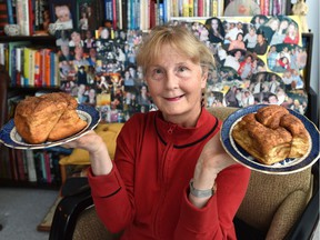Surrounded by photos of friends and staff from the Highlevel Diner, Kim Franklin poses at home with the restaurant's legendary cinnamon buns.