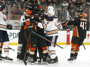 ANAHEIM, CALIFORNIA - JANUARY 06: The Anaheim Ducks and the Edmonton Oilers fight during the first period at Honda Center on January 06, 2019 in Anaheim, California.