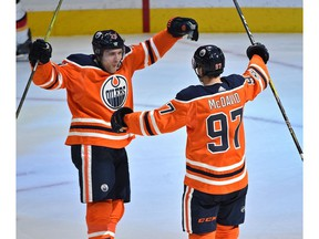 Edmonton Oilers Connor McDavid (97) celebrates with Leon Draisaitl (29) after scoring a hit trick against the Calgary Flames during the season opener of NHL action at Rogers Place in Edmonton, October 4, 2017. Ed Kaiser/Postmedia