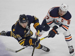 Buffalo Sabres Jack Eichel (15) and Edmonton Oilers' Conor McDavid (97) vie for the puck during the third period of an NHL hockey game, Friday Nov. 24, 2017, in Buffalo, N.Y.