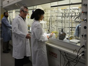 Todd L. Lowary, centre, in the GlycoNet laboratory.