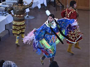 File: Aboriginal dancers from the Bent Arrow Traditional Healing Society performing a traditional Cree welcome dance at a multicultural welcome dinner for new Syrian refugees organized by the Mennonite Centre for Newcomers held at the Portuguese Canadian Hall in Edmonton, April 1, 2016.