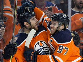 The Edmonton Oilers' Zack Kassian (44) an Connor McDavid (97) celebrate a third period goal against the Columbus Blue Jackets during third period NHL action at Rogers Place, in Edmonton Thursday March 21, 2019.